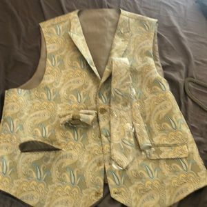 Suit vest with tie and bow tie never worn.